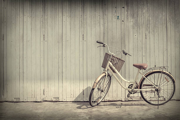 vintage bicycle on vintage wooden house wall stock photo