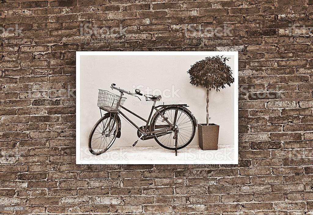 Vintage bicycle photo hang on old brick wall. stock photo
