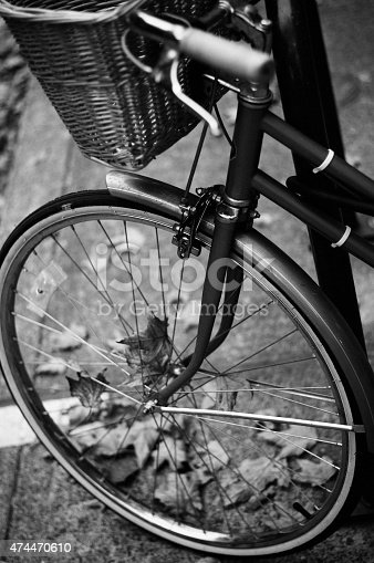 Vintage bicycle tire in downtown Portland Oregon photographed with black and white film.
