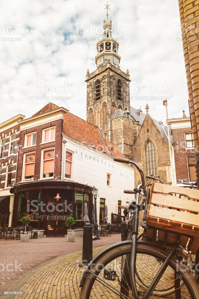 Vintage bicycle with basket in the city center of Gouda stock photo