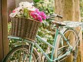 Vintage bicycle with flowers in basket