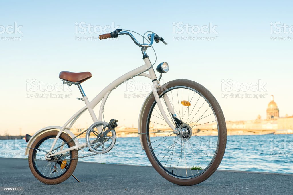 Vintage bike against Neva river stock photo