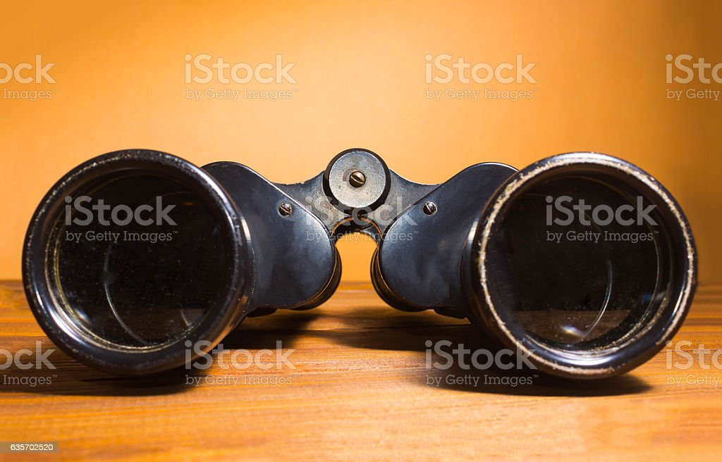 Vintage binoculars on wooden background royalty-free stock photo
