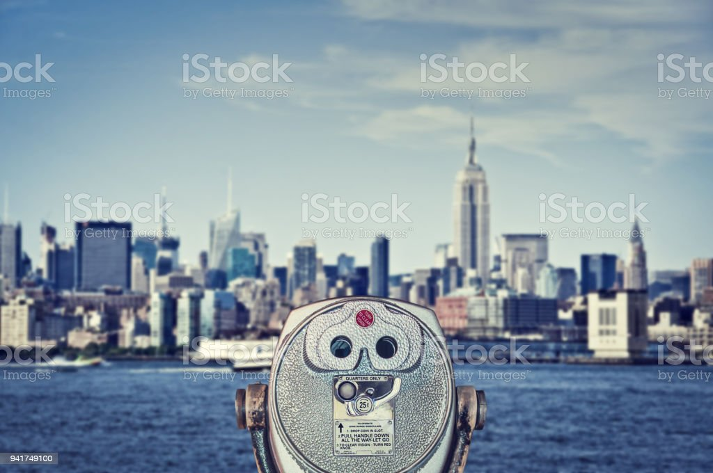 Vintage binoculars viewer, Manhattan skyline with the Empire State Building, New York City, USA stock photo