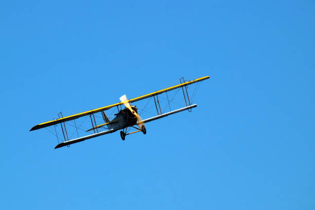 A vintage biplane angles for a turn stock photo