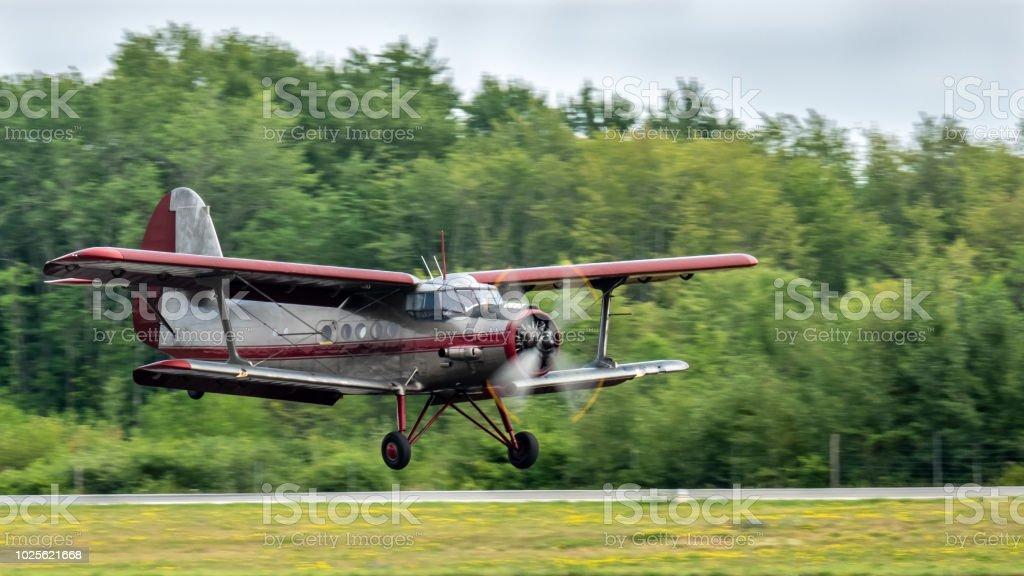 Vintage biplane landing stock photo