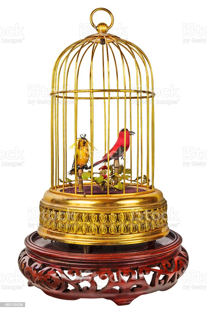 Vintage birdcage with fake little birds isolated on white stock photo