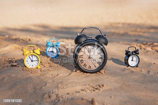 istock Vintage black alarm clock on autumn leaves. Time change abstract photo. 1055181032