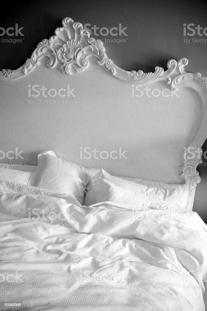 Vintage black and white photo of dreamy bed stock photo