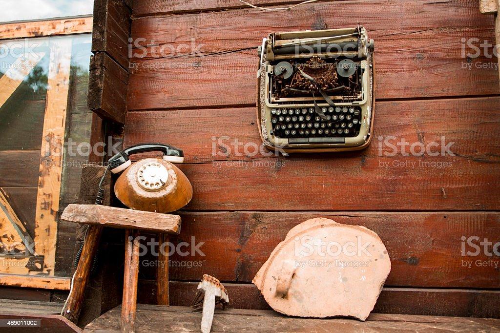 Vintage Black, Manual Typewriter on Wood Trunk stock photo