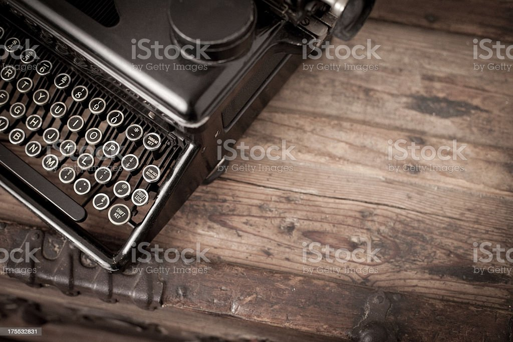 Vintage Black, Manual Typewriter on Wood Trunk, With Copy Space stock photo