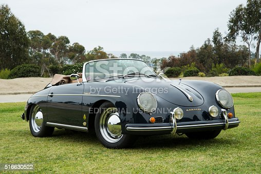 Dana Point, CA, USA - July 21, 2013: An angled perspective near the beach of an exceptionally rare and vintage Black Porsche 356B Convertible D