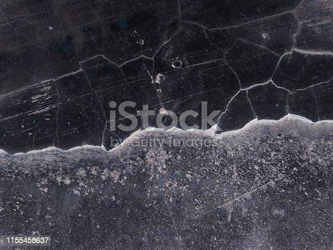 istock Vintage black wall with cracks 1155458637