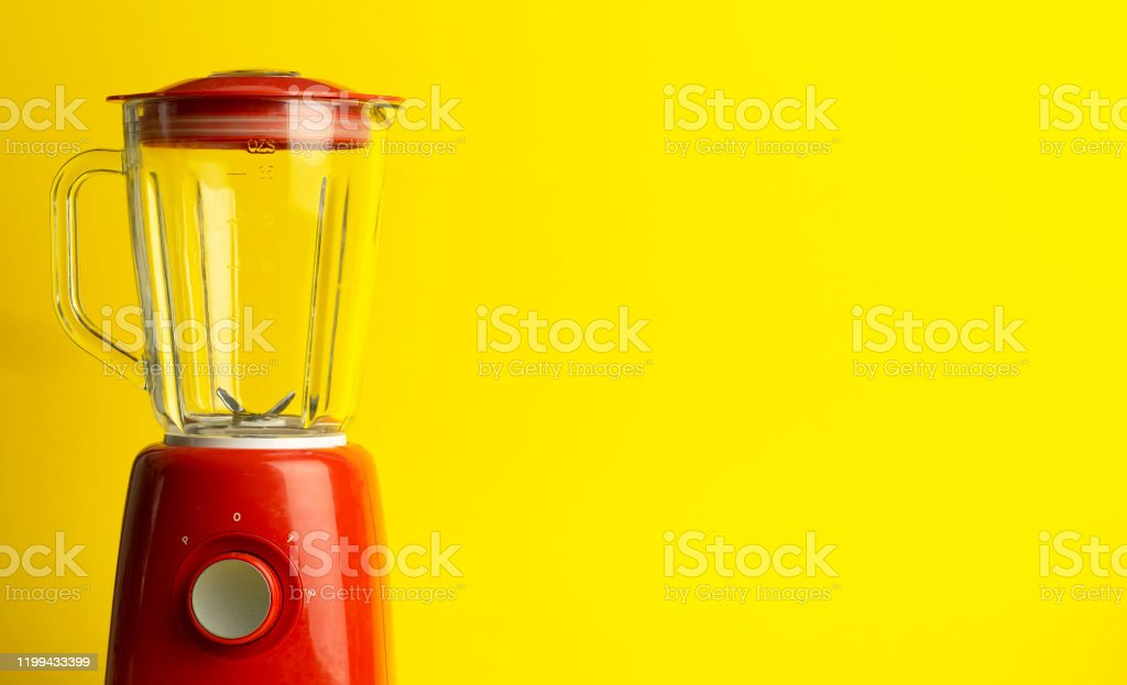 Vintage blender for cocktails and homemade food. Red blender on a yellow background. Minimal art concept, copy space - Royalty-free Appliance Stock Photo