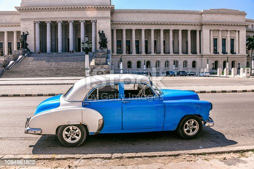istock Vintage Blue Car In Front Of El Capitolio of Havana, Cuba 1094961822