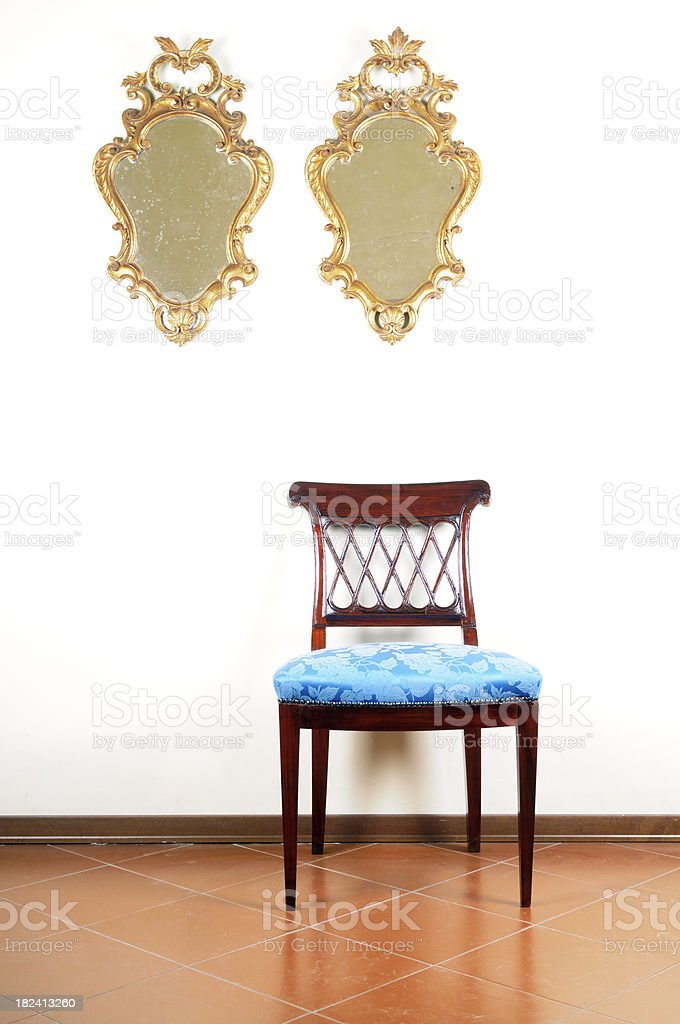 Vintage Blue Chair and Pair of Old Gold Mirrors royalty-free stock photo