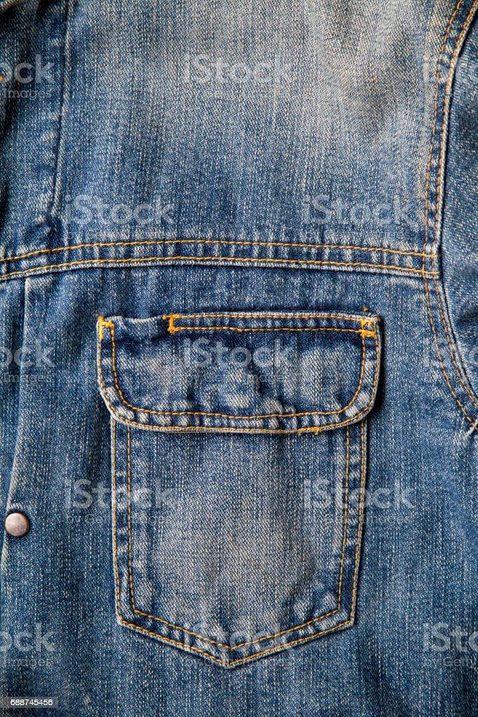 vintage blue denim jacket pocket,fabric texture stock photo