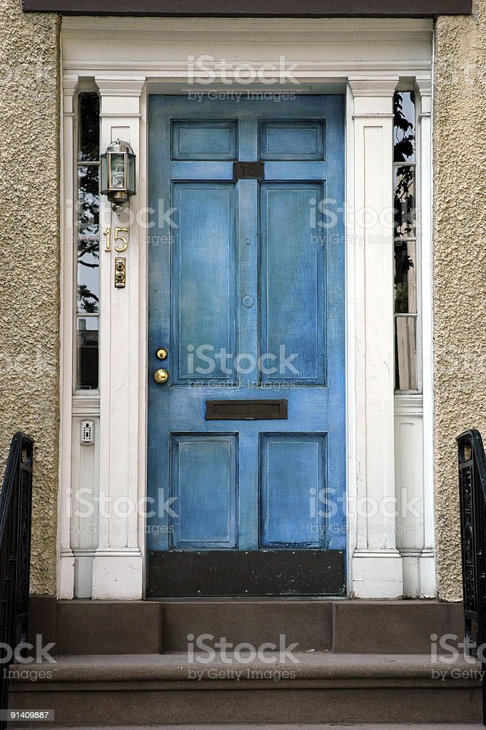 Vintage blue door on number fifteen house royalty-free stock photo