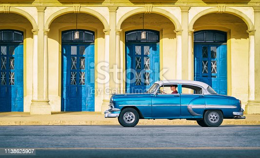 Vintage blue oldtimer car driving through Old Havana Cuba