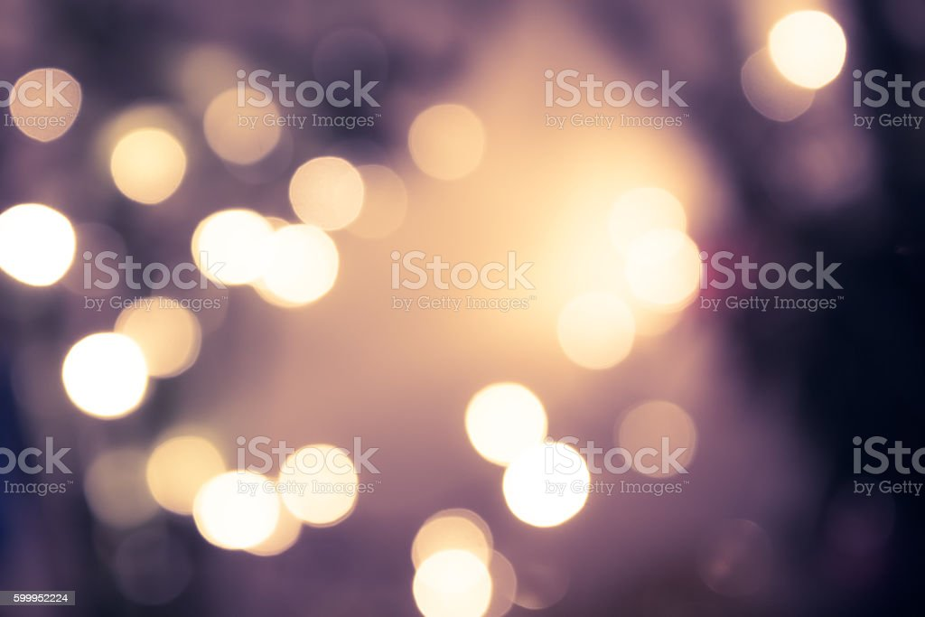 Vintage blue toned bokeh with blurred sparkling christmas lighting stock photo