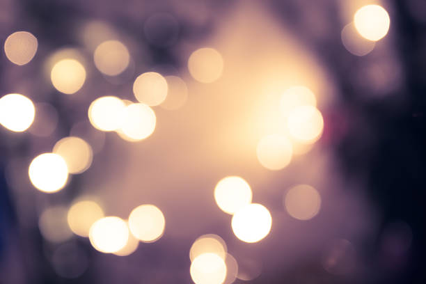 vintage blue toned bokeh with blurred sparkling christmas lighting stock photo - Sparkling Christmas Lights