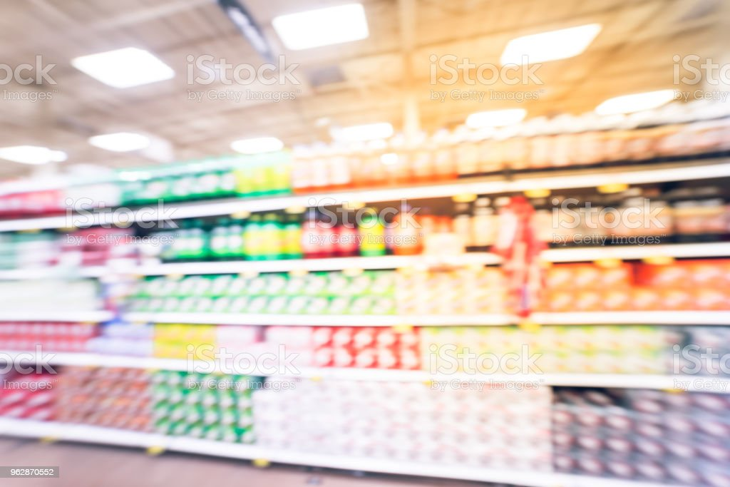 Vintage blurred image soft drinks aisle in American store. The...