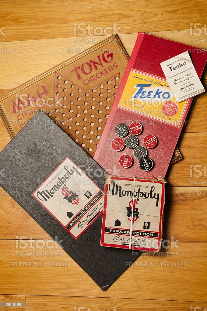 An assortment of vintage board games includes the banking game...