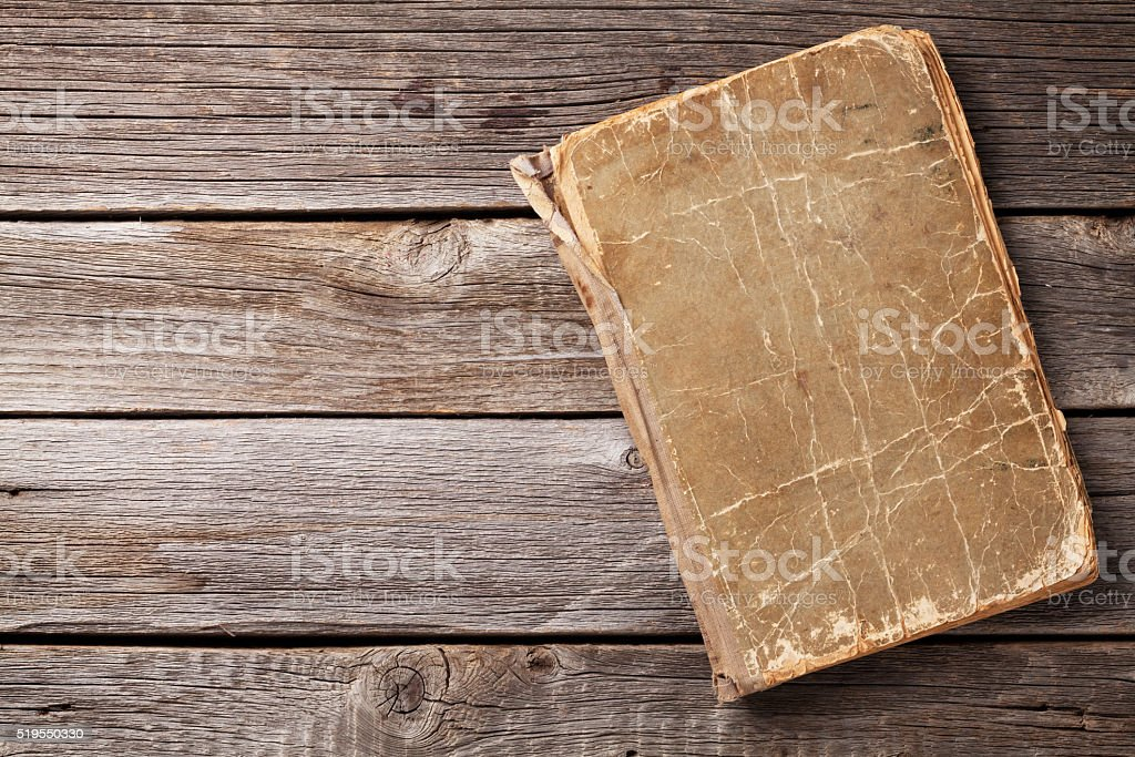 Vintage book on wood stock photo