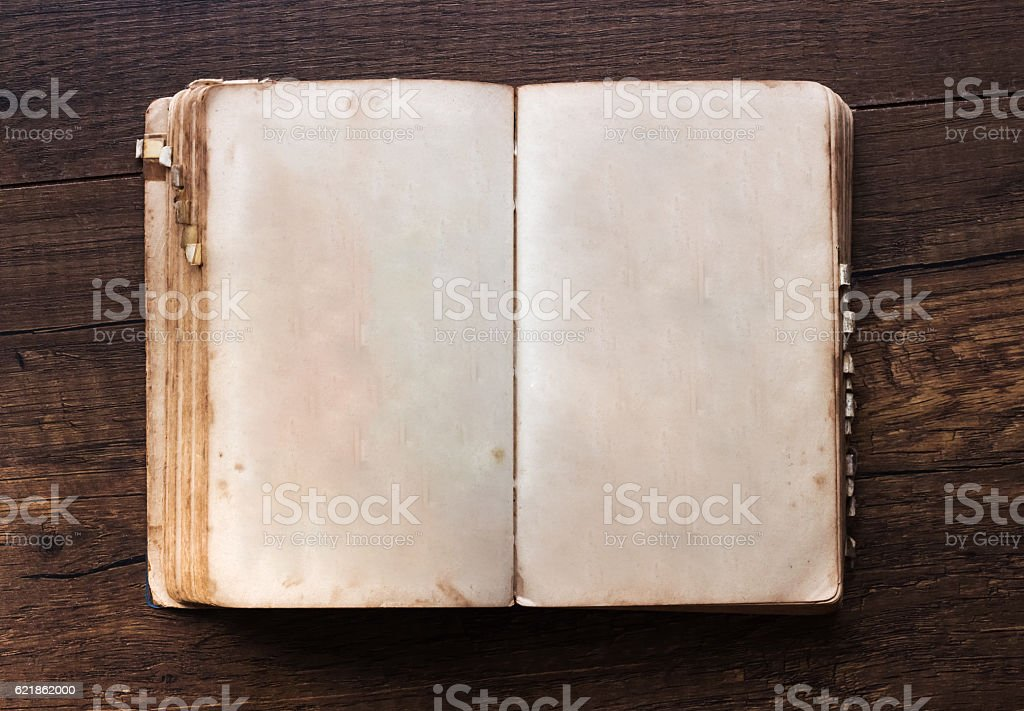 Vintage book, open, on old wooden table. stock photo