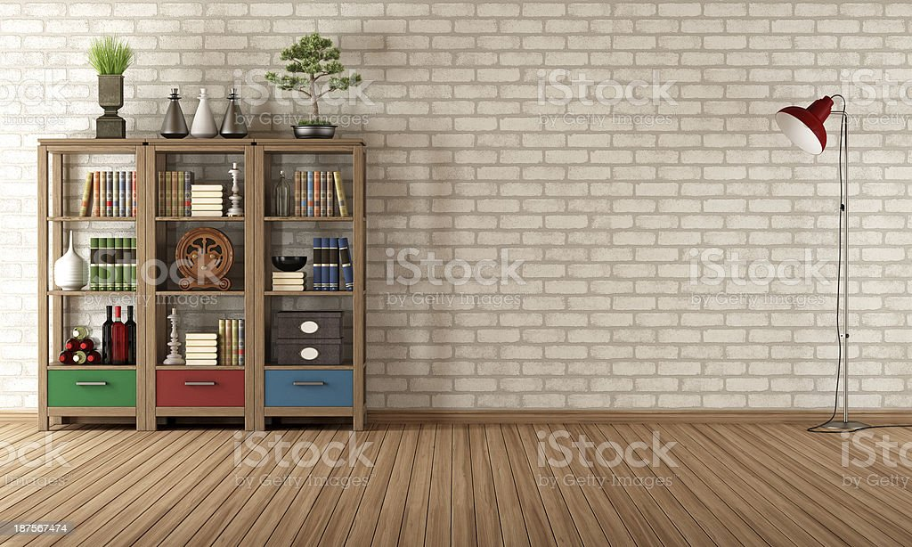 Vintage bookcase in a empty room stock photo