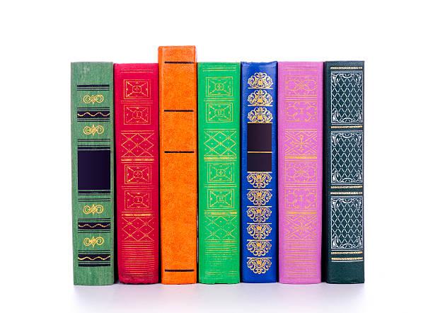 vintage books in a row - stekels stockfoto's en -beelden