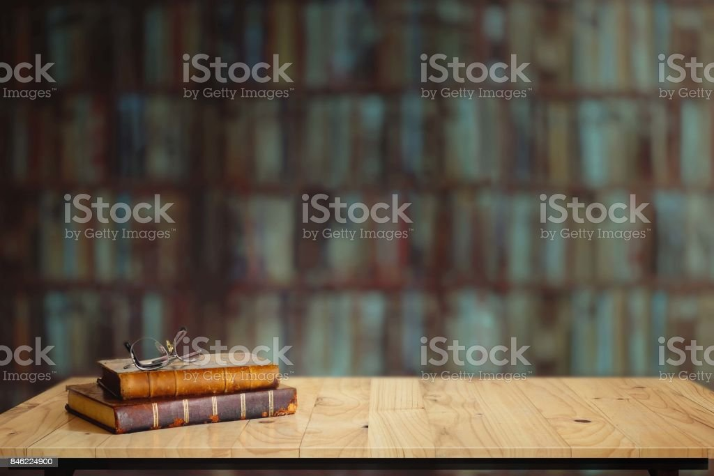 Vintage books on table in library.