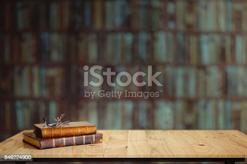 istock Vintage books on table in library. 846224900