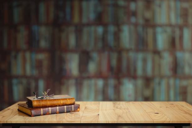 Vintage books on table in library. stock photo
