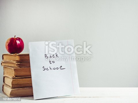 istock Vintage books, pencils, notepad with a handwritten inscription 1018375310