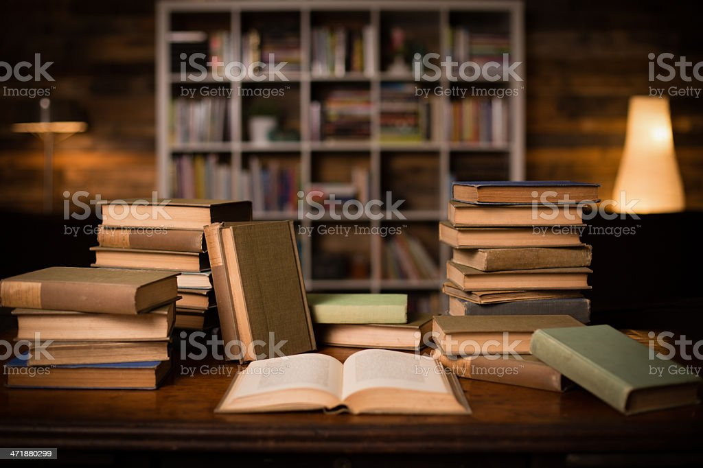 Vintage Books Sitting on Old Desk, With Shelved Wall Background stock photo