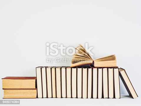 istock Vintage books with yellow pages on a white table 945074094