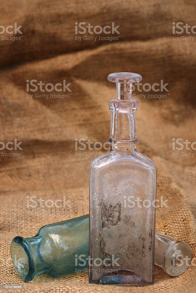 Vintage bottles on burlap royalty-free stock photo