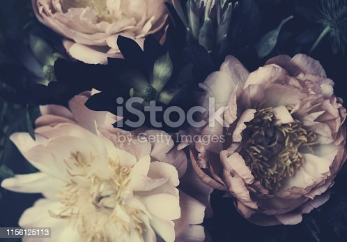 istock Vintage bouquet of beautiful peonies on black. Floristic decoration. Floral background. Baroque old fashiones style. Natural flowers pattern wallpaper or greeting card 1156125113