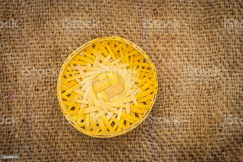 Vintage bowl made from bamboo on gunny bag. stock photo