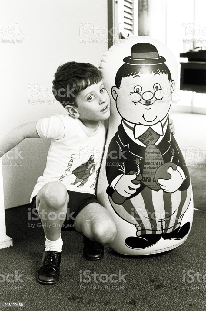 Vintage boy with big doll stock photo
