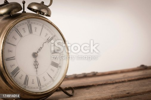 Close up, color image of a vintage brass, footed clock, on white background.  Includes room for your text.