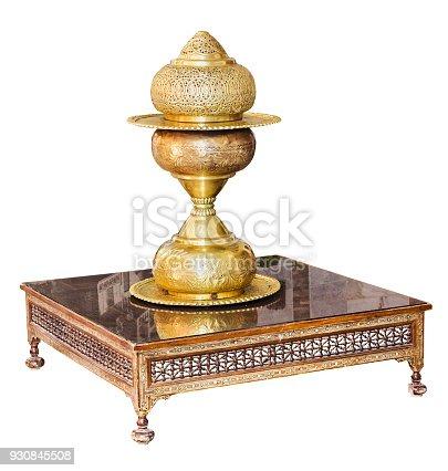 686515422istockphoto Vintage brass vase on table isolated on white 930845508