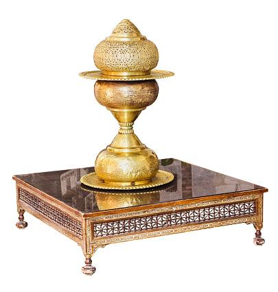 686515422 istock photo Vintage brass vase on table isolated on white 930845508