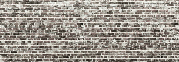 Vintage brick matte - Weathered texture of stained old dark brown and red brick wall background, grungy rusty blocks of stone - Old rustic grunge industrial pattern architectural - Vintage Brick Work stock photo