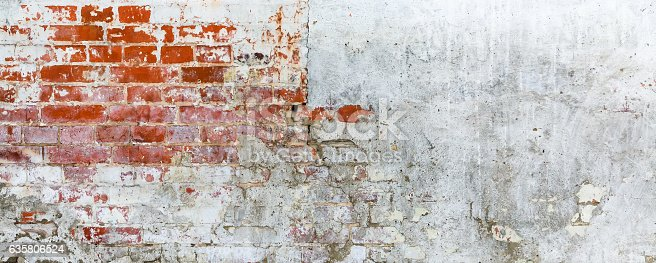 istock Vintage brick rough rustic wall with cracked plaster 635806524