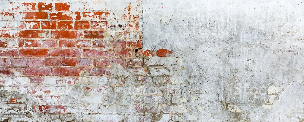 Vintage brick rough rustic wall with cracked plaster stock photo
