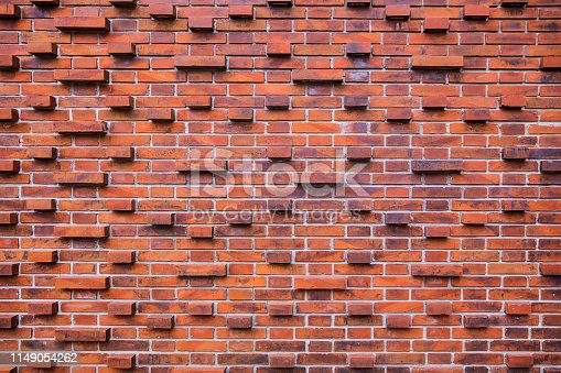 Close up exposed brick sticking out from the wall