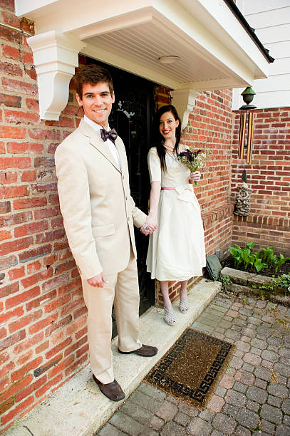 Vintage Bride and Groom posing for photos stock photo