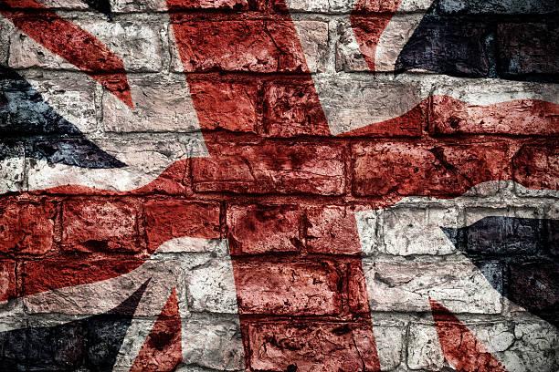 Vintage british flag on brick wall stock photo